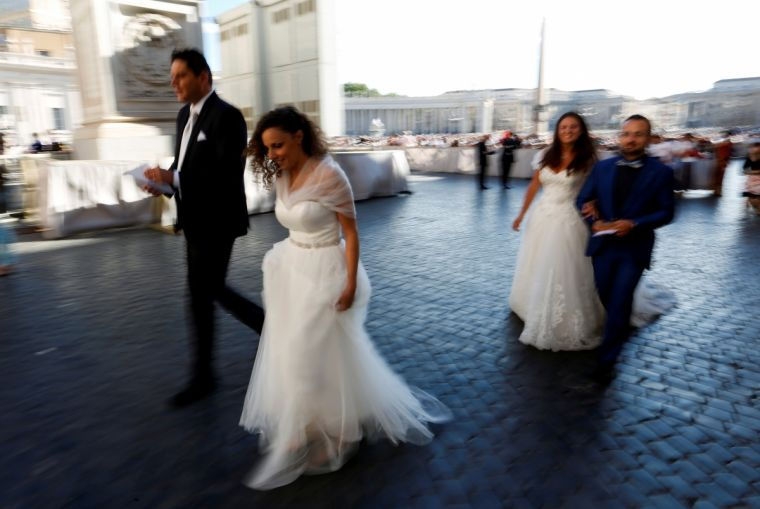 Newly-married couples arrive at the Pope's weekly audience last Wednesday