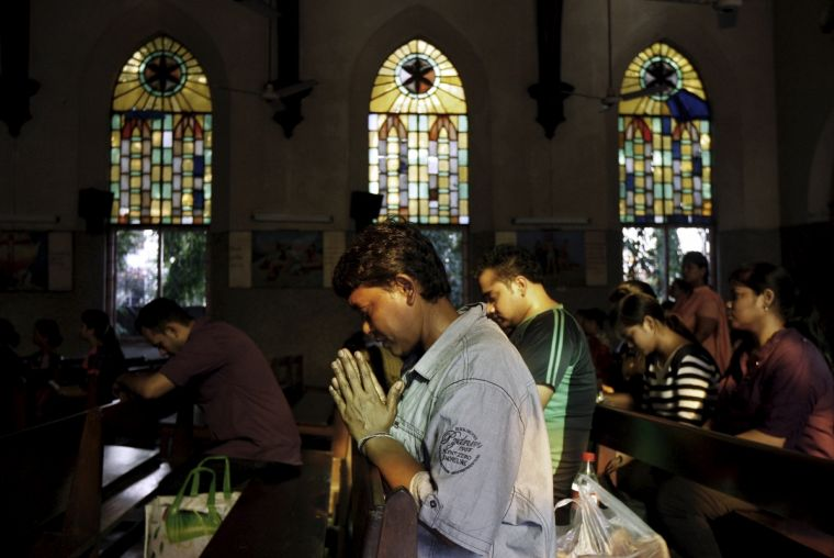 Christians pray at a church in Kolkata