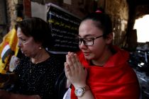 a-christian-prays-for-victims-of-a-suicide-car-bomb-attack-in-karrada-baghdad-in-july
