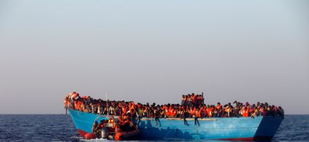 a-rescue-boat-of-the-spanish-ngo-proactiva-approaches-an-overcrowded-wooden-vessel-with-migrants-from-eritrea-off-the-libyan-coast-in-the-mediterranean-last-month