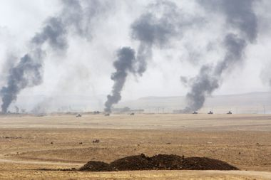 Smoke rises from clashes with Islamic State militants on the southeast of Mosul, Iraq.