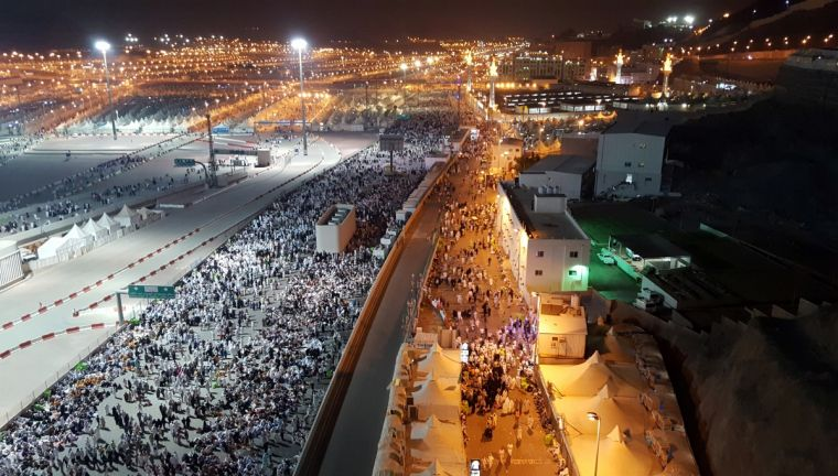 Muslim pilgrims walk on roads as they head to cast stones at pillars symbolizing Satan during the annual haj pilgrimage in Mina earlier this month. Churches are banned in Saudi Arabial.