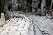stacks-of-bread-pictured-today-at-a-damaged-site-after-an-airstrike-in-the-rebel-held-bab-al-maqam-neighbourhood-of-aleppo-syria