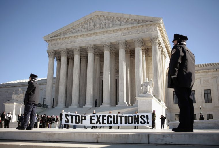 Protesters against the death penalty unfurl a banner outside the US Supreme Court in Washington.