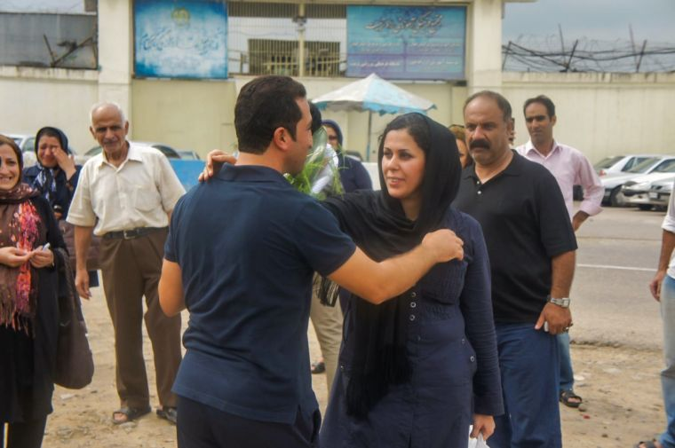Youcef and Tina Nadarkhani greet each other on his release from prison in 2012
