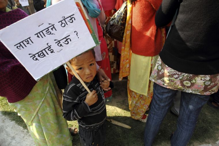 A Christian boy holds a placard in a Christian protest in Nepal, where Christians account for less than two percent of Hindu-majority Nepal's 28 million people.