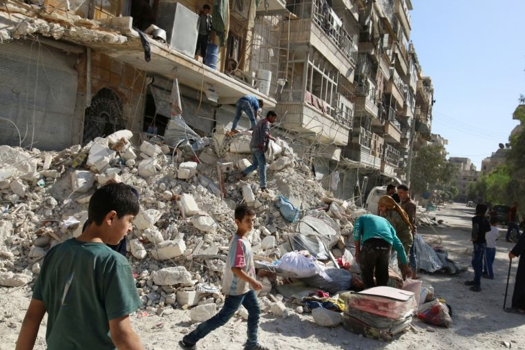 Damage after an airstrike in a rebel held area of Aleppo on Sunday