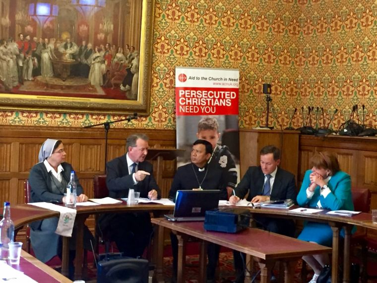 Aid to the Church in Need speakers addressing MPs and members of the House of Lords