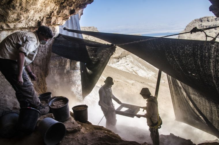 Archaeological excavation in search of ancient artifacts in the Cave of the Skulls in the Judean Desert