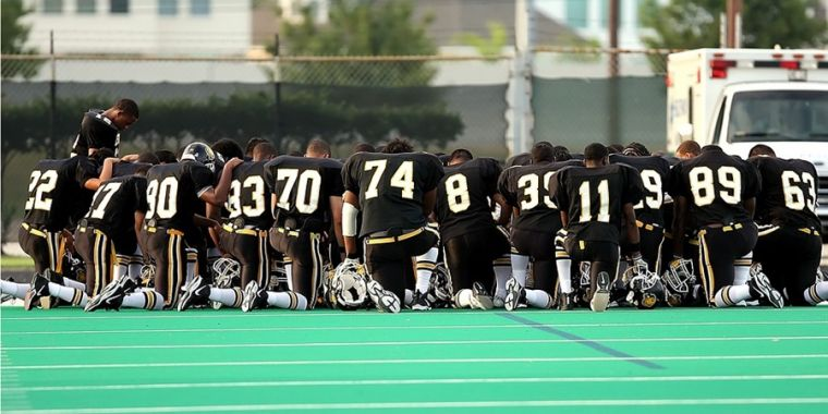 Football team in prayer