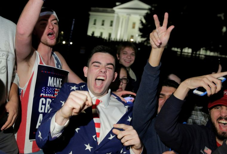 Supporters of Donald Trump celebrate on the White House lawn this morning