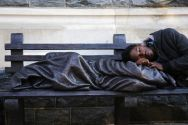 a-man-sleeps-on-the-sculpture-of-homeless-jesus-in-front-of-the-archdiocese-of-washington-catholic-charities-offices-in-washington
