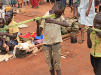 martin-andrea-10-and-a-friend-play-with-toy-guns-made-fromreeds-at-a-displaced-persons-camp-protected-by-un-peacekeepers-in-wau-south-sudan