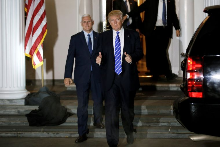 Donald Trump and Mike Pence depart the main clubhouse at Trump National Golf Club