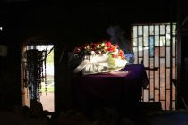 a-rose-bouquet-is-laid-on-a-coffin-in-the-catholic-church-in-nyamata-containing-the-remains-of-victims-of-mass-killings-during-the-1994-genocide