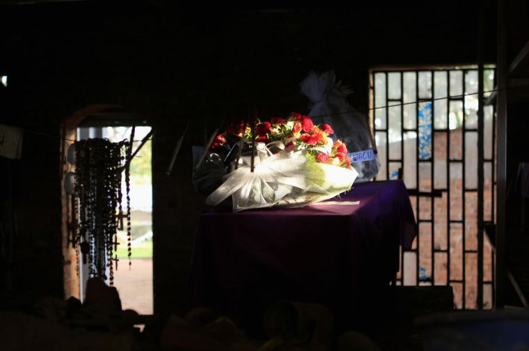 A rose bouquet is laid on a coffin in the Catholic church in Nyamata containing the remains of victims of mass killings during the 1994 genocide.