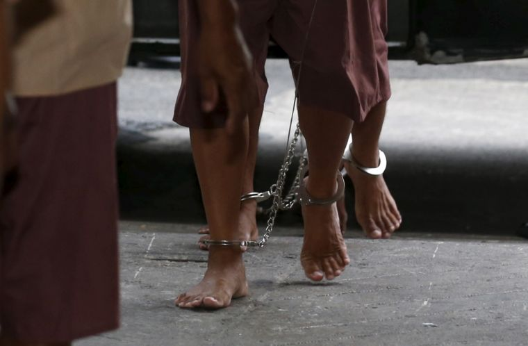 Suspected human traffickers arrive for trial at the criminal court in Bangkok, Thailand earlier this year.
