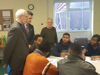 The Archbishop of Canterbury with refugees at the Coventry Refugee and Migrant Centre