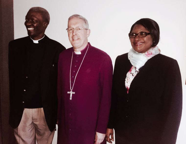 Woyin Karowei Dorgu with his wife Mosun and the Bishop of Southwark