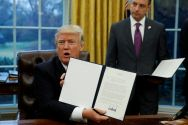 on-his-first-full-day-in-office-donald-trump-signs-executive-orders-in-the-oval-office