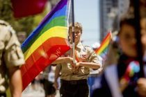 boy-scout-carrying-lgbt-rainbow-flag