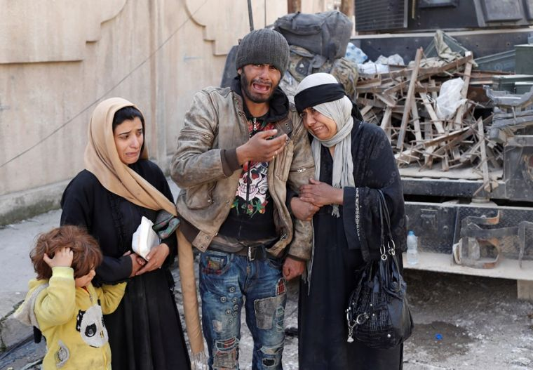 Crying Mosul residents