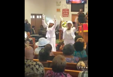mom-stands-up-to-praise-god-at-the-front-of-the-church-then-others-follow-her-to-the-front