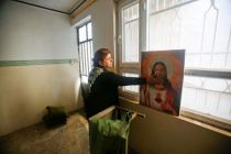 a-christian-woman-inspects-a-home-in-the-town-of-bartella-east-of-mosul-iraq-after-it-was-liberated-from-islamic-state-militants-november-23-2016