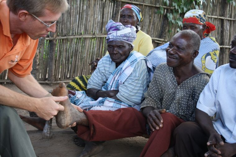 Arie examines the foot of a leprosy patient