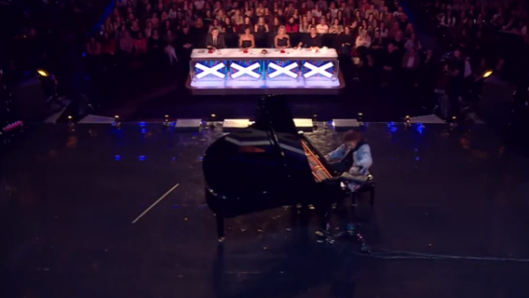 boy-from-a-bad-neighborhood-starts-playing-classical-piano-but-the-crowd-goes-wild-when-he-pushes-a-button