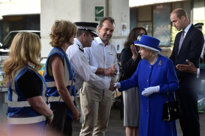 The Queen and Prince William meet emergency workers near Grenfell Tower