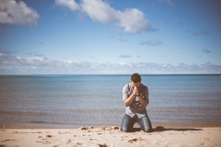 Prayer on the beach