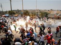 palestinians-react-following-tear-gas-that-was-shot-by-israeli-forces-after-friday-prayer-on-a-street-outside-jerusalems-old-city