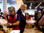 u-s-president-donald-trump-helps-volunteers-hand-out-meals-during-a-visit-with-flood-survivors-of-hurricane-harvey