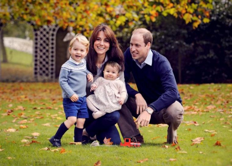 Britain's Prince William, his wife Kate, and their children George and Charlotte pose in late October 2015