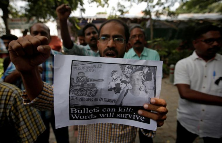 A protester displays a placard during a protest rally against the killing of Gauri Lankesh, an Indian journalist, in New Delhi, India, September 6, 2017