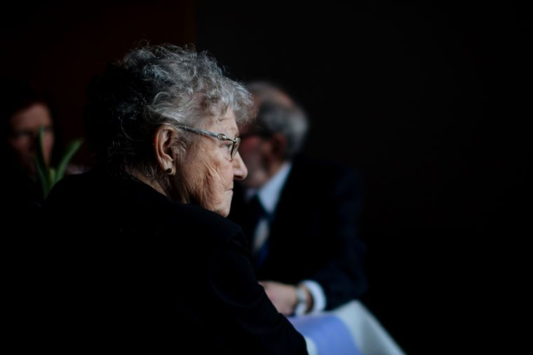 An elderly lady lost in thought