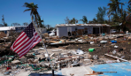 a-u-s-flag-flies-over-a-debris-field-of-former-houses-following-hurricane-irma-in-islamorada-florida-u-s