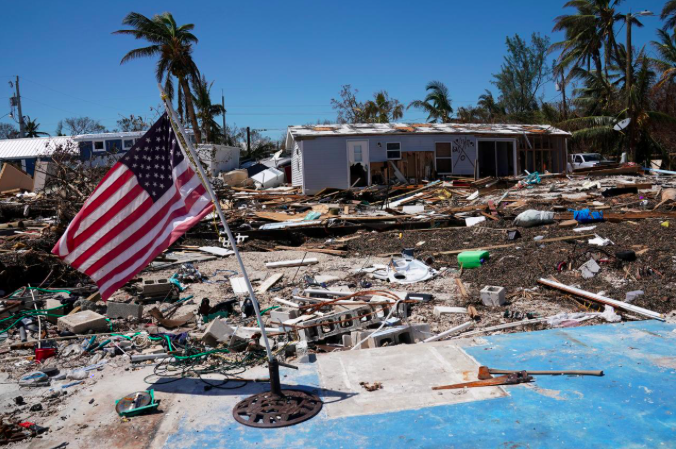 A U.S. flag flies over a debris field of former houses following Hurricane Irma in Islamorada, Florida, U.S