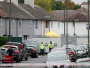 police-officers-stand-in-front-of-barriers-forming-a-cordon-around-a-property-being-searched-after-a-man-was-arrested-in-connection-with-an-explosion-on-a-london-underground-train-in-sunbury-on-thames-britain-september-17-2017