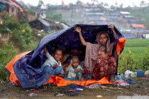rohingya-refugees-shelter-from-the-rain-in-a-camp-in-coxs-bazar-bangladesh-september-17-2017