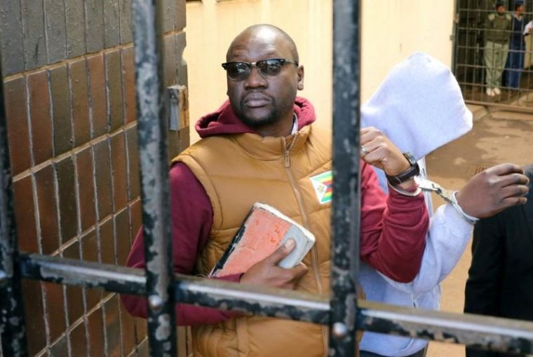Handcuffed Pastor Evan Mawarire arrives at court after he was arrested in Harare, Zimbabwe June 28, 2017.