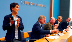 frauke-petry-chairwoman-of-the-anti-immigration-party-alternative-fuer-deutschland-afd-leaves-a-news-conference-next-to-joerg-meuthen-2nd-l-leader-of-the-party