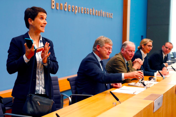 Frauke Petry, chairwoman of the anti-immigration party Alternative fuer Deutschland (AfD) leaves a news conference next to Joerg Meuthen (2nd L), leader of the party.