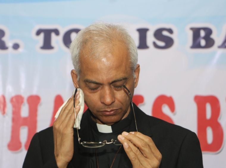 Father Tom Uzhunnalil sheds a tear at his homecoming