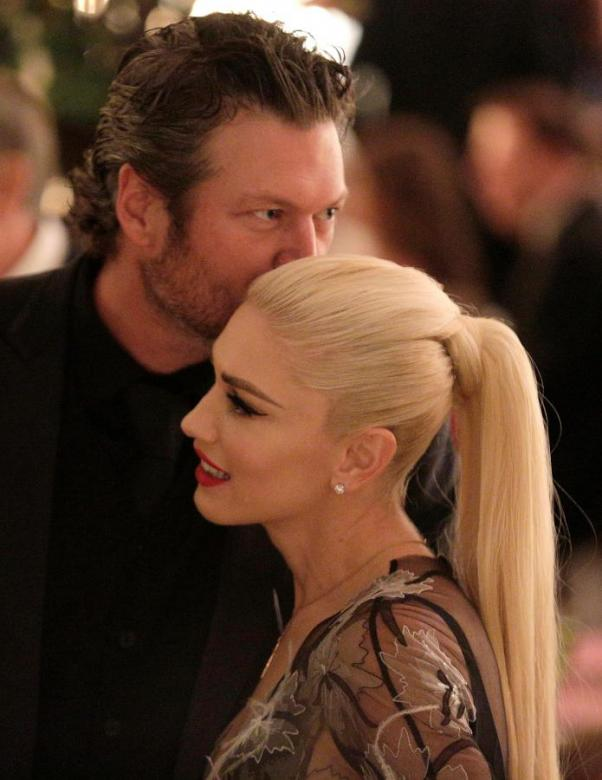 REUTERS  Joshua Roberts Singer Gwen Stefani receives a kiss from Blake Shelton