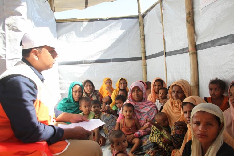Darren D'Costa working with children in a refugee camp in Bangladesh