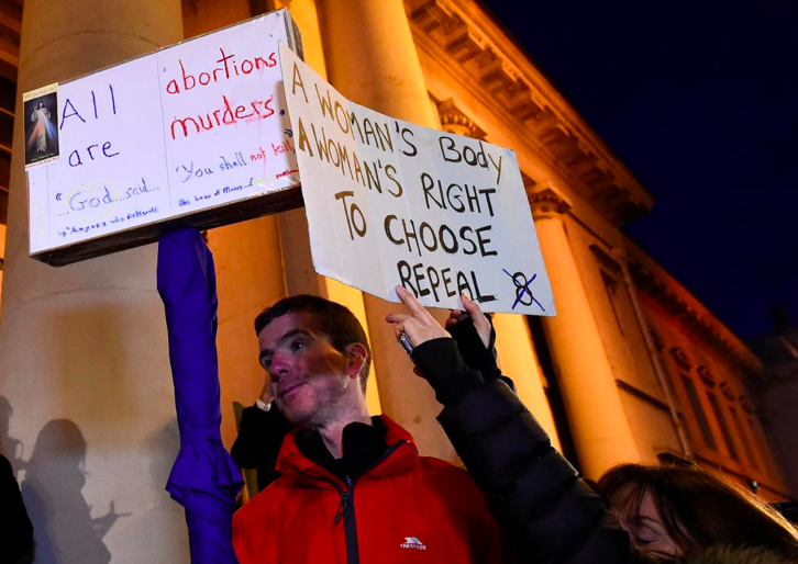 An anti-abortion protestor interrupts speeches during a march for more liberal Irish abortion laws