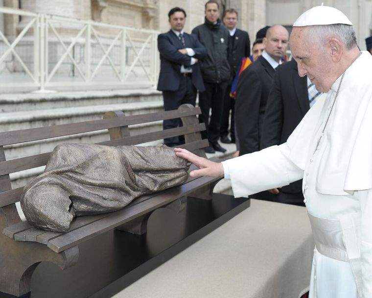 Pope Francis blesses the 'Homeless Jesus' sculpture