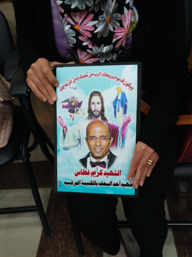 Mary Edwar holds an image of her late husband Kareem Ghattas